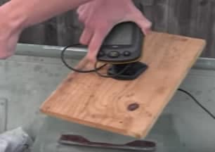 Fish finder console attached to wooden board