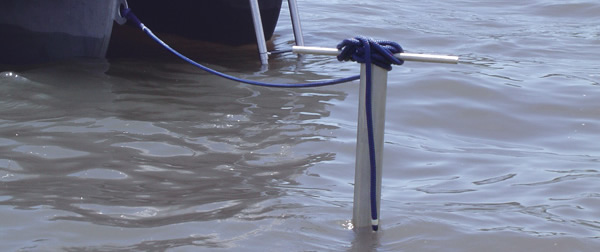 boat tethered to shallow water pole