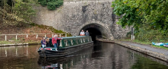 narrowboat coming out of tunnel