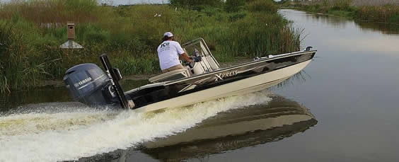 shallow draft boat in shallow water