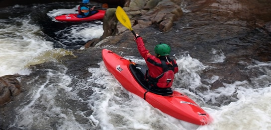 whitewater sit-in kayak in rapids