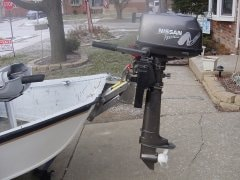 outboard motor mounted via bracket to drift boat