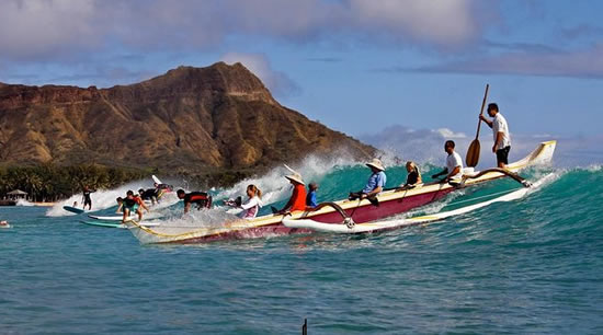 outrigger canoe riding wave