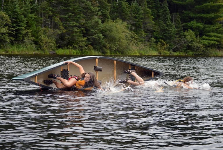 Canoe tipping over in water