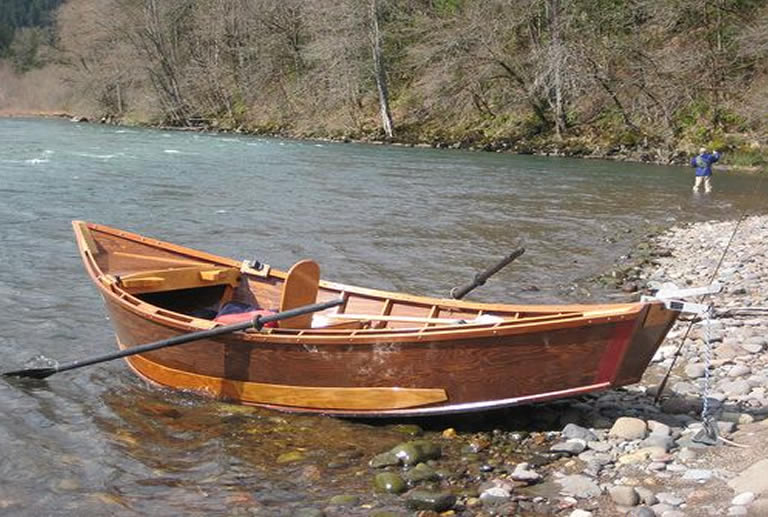A drift boat anchored on river