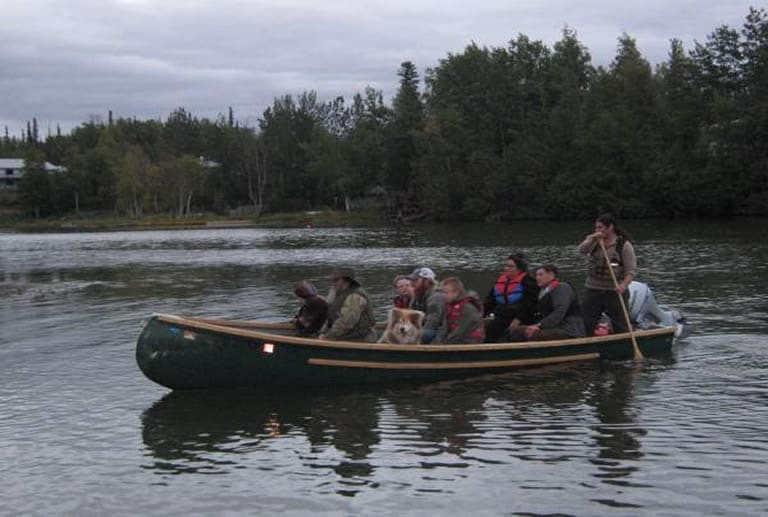 A freighter canoe filled with passengers