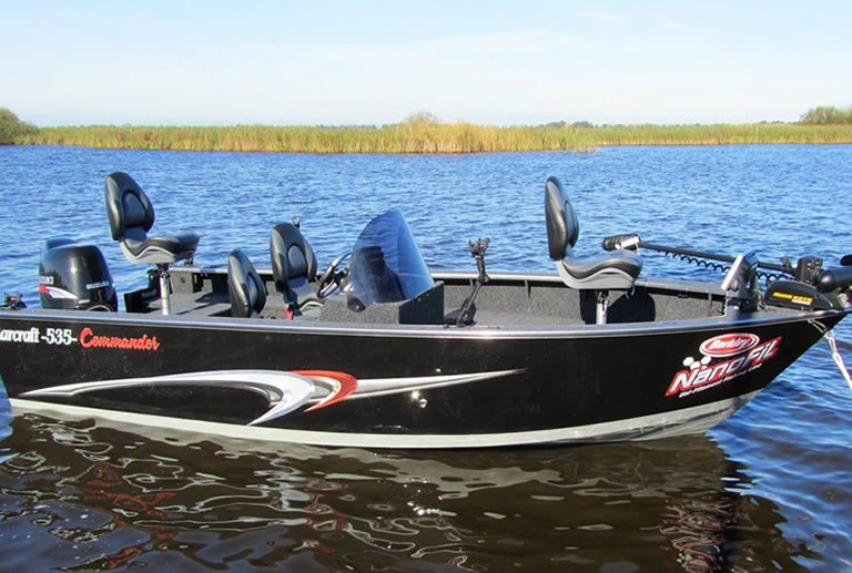 Bass boat in shallow lake water