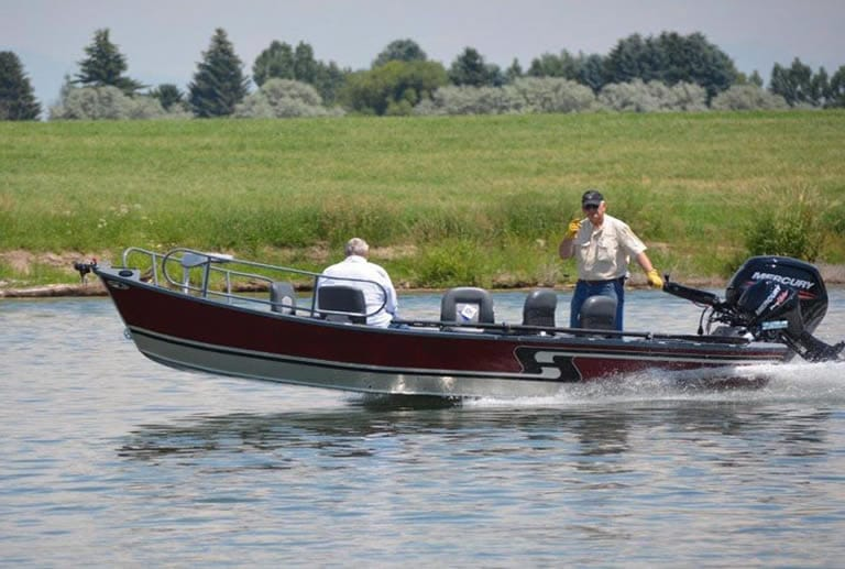 Drift boat powered by outboard motor on river
