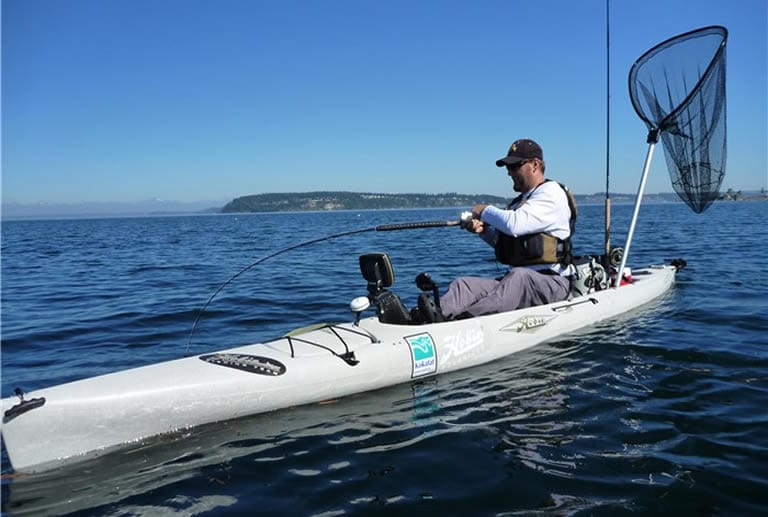 Hobie fishing kayak in large lake
