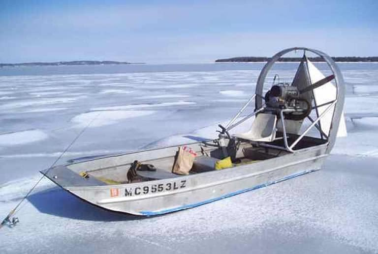 Fishing airboat on the ice