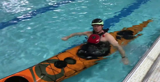 Foam filled kayak floating just beneath the waterline with paddler still inside