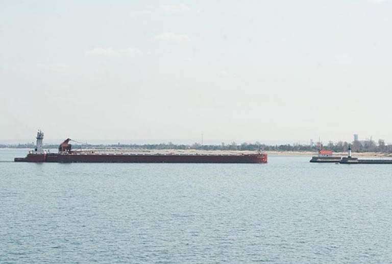 Tug barge approaching bay from ocean